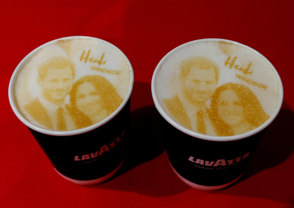 . Cappuccino coffees with the images of Britain\'s Prince Harry and Meghan Markle on top are pictured at a coffee shop in Windsor, Tuesday, May 15, 2018. Preparations are being made in the town ahead of the wedding of Britain\'s Prince Harry and Meghan Markle that will take place in Windsor on Saturday May 19. (AP Photo/Frank Augstein)