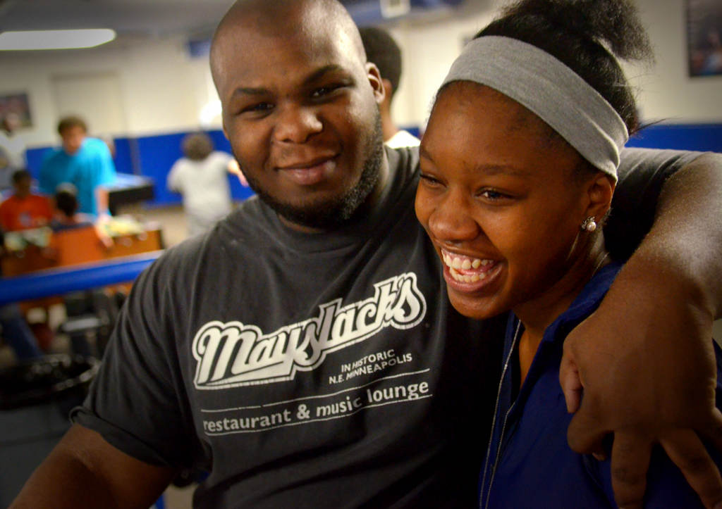 . Shabazz gets a hub from longtime friend and Teen Center volunteer Demitrious Byas. (Pioneer Press: John Autey)