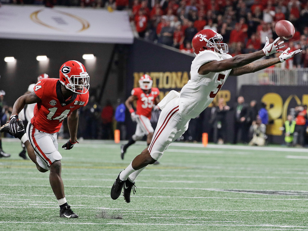 . Alabama wide receiver Calvin Ridley can\'t catch a pass during the second half of the NCAA college football playoff championship game against Georgia Monday, Jan. 8, 2018, in Atlanta. (AP Photo/David J. Phillip)