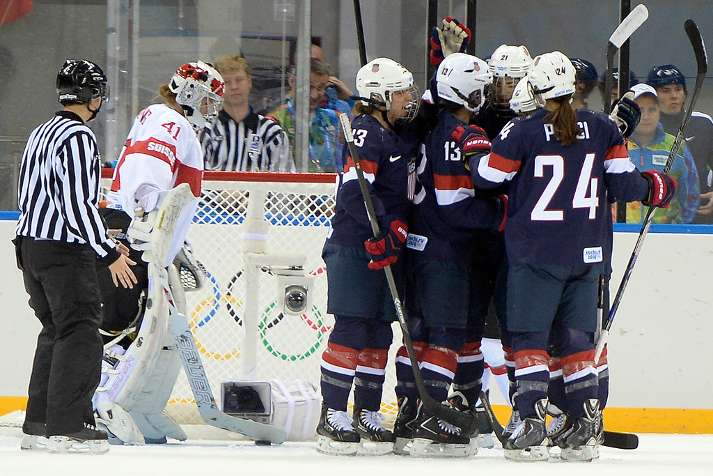 . Florence Schelling (41) of the Switzerland reacts to giving up a goal to Julie Chu (13) of the U.S.A. during the first period of action at the Shayba Arena. Sochi 2014 Winter Olympics on Monday, February 10, 2014. (Photo by AAron Ontiveroz/The Denver Post)