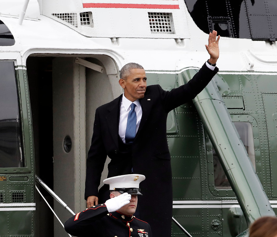 . Former President Barack Obama waves as he boards a Marine helicopter during a departure ceremony on the East Front of the U.S. Capitol in Washington, Friday, Jan. 20, 2017, after President Donald Trump was inaugurated. (AP Photo/Evan Vucci)