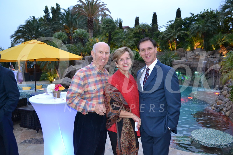 Bill and Laura Olhasso with YMCA CEO Tyler Wright.JPG