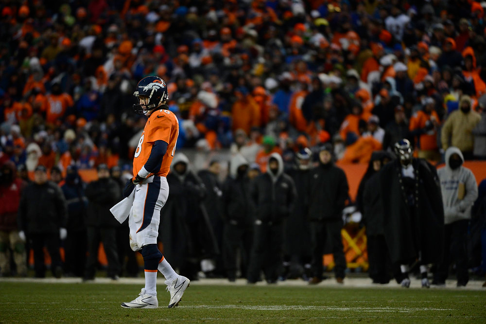 Description of . Denver Broncos quarterback Peyton Manning (18) waits for a call on a play under review. The Denver Broncos vs Baltimore Ravens AFC Divisional playoff game at Sports Authority Field Saturday January 12, 2013. (Photo by Joe Amon,/The Denver Post)