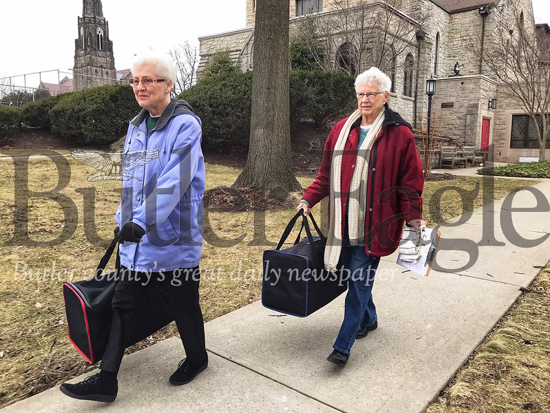 Butler resident Peggy Loomis and Evelyn Kennedy, who has volunteered for 15 years with Butler Meals on Wheels, prepare their meals for delivery on Tuesday.