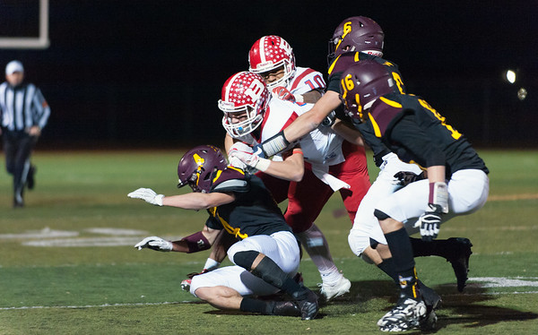 12/03/18 Wesley Bunnell | Staff Berlin football defeated Sheehan on Monday evening at Sheehan High School to advance to the class M championship game vs St. Joe's. Marco Scarano (5) lead blocks for Larry St. Pierre Jr. (10).