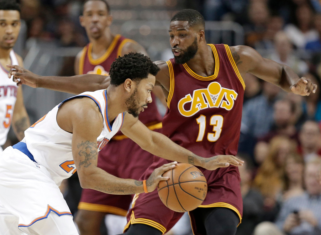 . New York Knicks\' Derrick Rose, left, drives past Cleveland Cavaliers\' Tristan Thompson in the first half of an NBA basketball game, Thursday, Feb. 23, 2017, in Cleveland. (AP Photo/Tony Dejak)