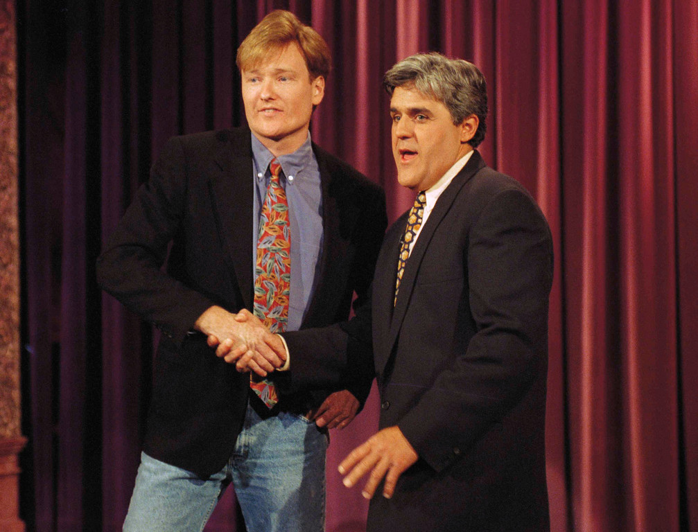 """. Conan O\'Brien, left, who will take David Letterman\'s spot on \'Late Night,\' is welcomed to NBC by Jay Leno during taping of \""""The Tonight Show,\"""" April 26, 1993 in Burbank, California. O\'Brien, was a former writer for \""""Saturday Night Live.\""""  (AP Photo/Julie Markes)"""