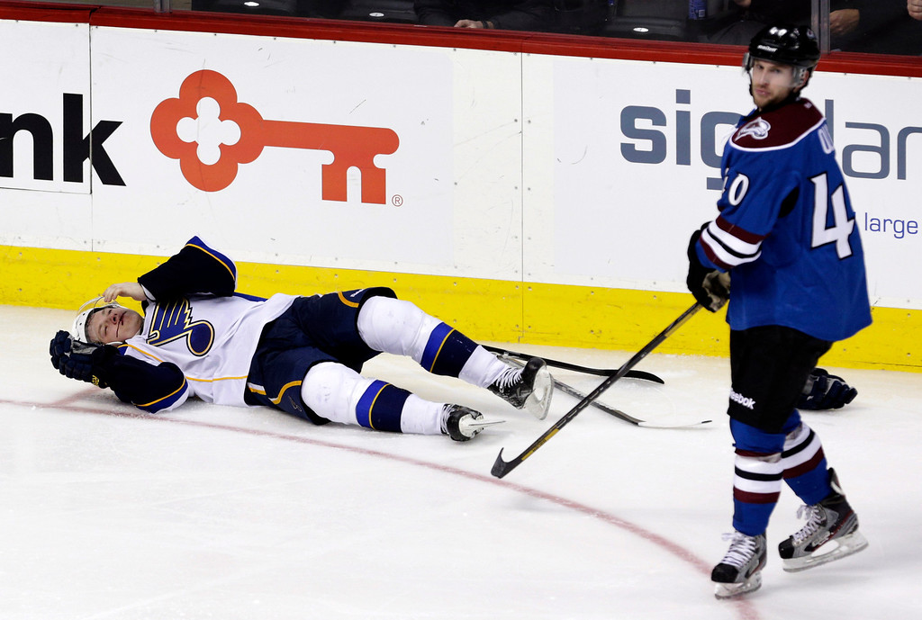 . St. Louis Blues right wing Vladimir Tarasenko, of Russia, (91) lays on the ice after colliding with Colorado Avalanche center Mark Olver (40) during the third period of an NHL hockey game, Wednesday, Feb. 20, 2013, in Denver. Colorado won 1-0 in overtime. (AP Photo/Joe Mahoney)