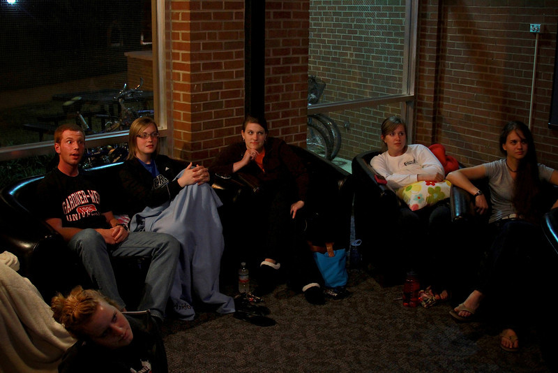 Students take time to hang out and enjoy a movie in the dorm lobby and lounge.