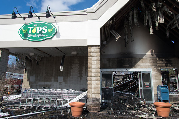 03/04/19 Wesley Bunnell | Staff Fire destroyed Tops Marketplace located at 887 Meriden-Waterbury Tpke in Southington on Monday night. The Tops sign shown the left side of the main entrance.