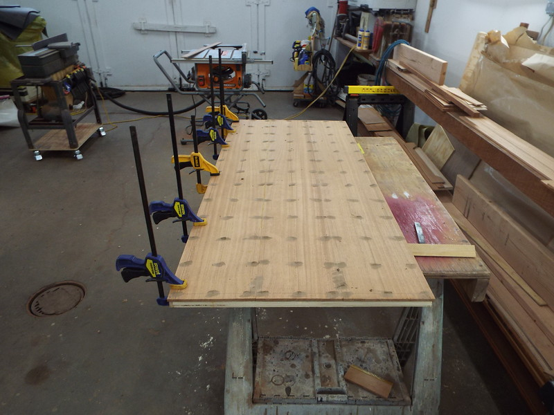 Desk top with Mahogany skin glued in place and puttied.