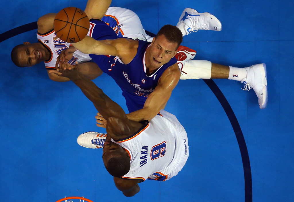 . Blake Griffin #32 of the Los Angeles Clippers takes a shot against Russell Westbrook #0 and Serge Ibaka #9 of the Oklahoma City Thunder in Game One of the Western Conference Semifinals during the 2014 NBA Playoffs at Chesapeake Energy Arena on May 5, 2014 in Oklahoma City, Oklahoma.   (Photo by Ronald Martinez/Getty Images)