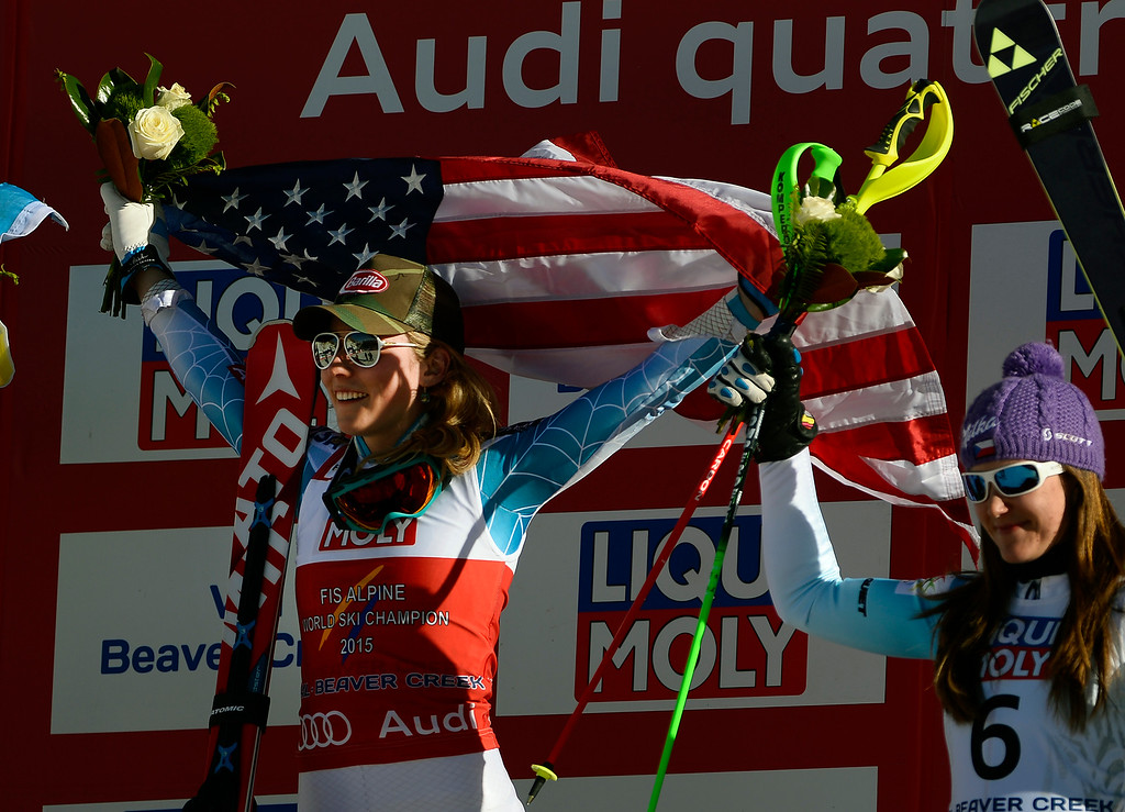 . Mikaela Shiffrin of the United States holds up an American flag during the flower ceremony after winning gold in the the Ladies slalom at the FIS Alpine World Ski Championships in Beaver Creek, CO. February 14, 2015. Shiffrin came in first and took home the gold medal. (Photo By Helen H. Richardson/The Denver Post)