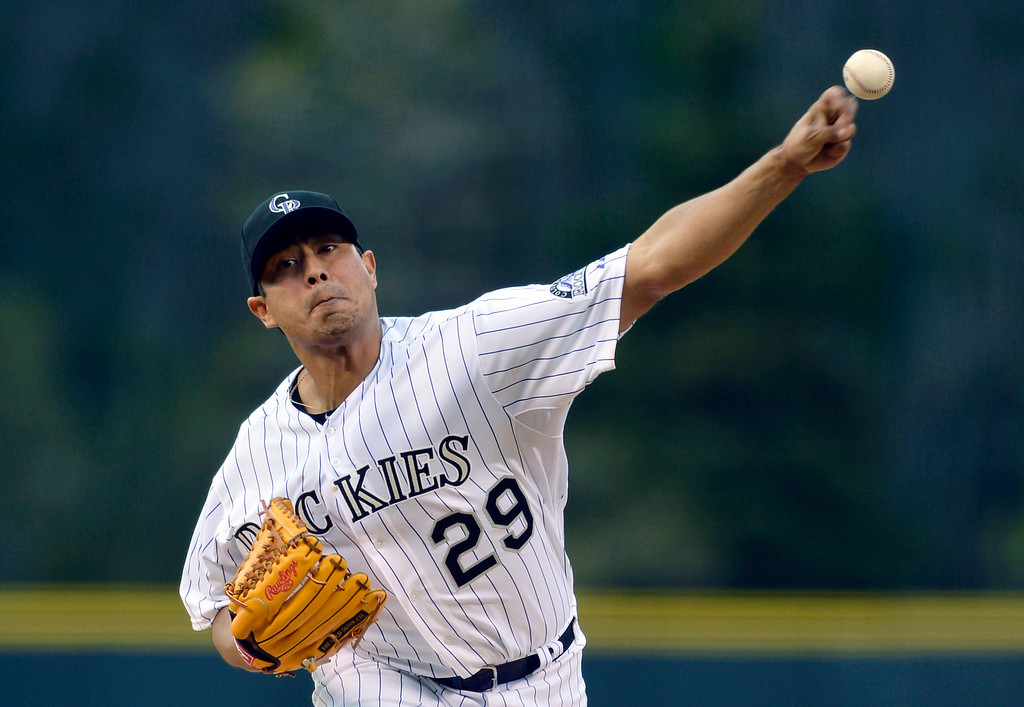 . Colorado Rockies starting pitcher Jorge De La Rosa (29) throws to the plate against the New York Mets during the first inning of a baseball game, Friday, May 2, 2014, in Denver. (AP Photo/Jack Dempsey)