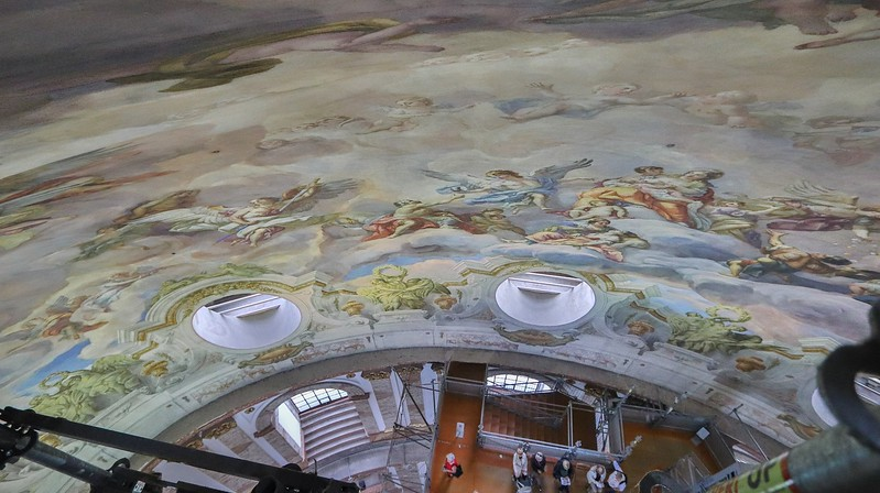 Figures are painted in distorted proportions so they will look normal when viewed from the floor.