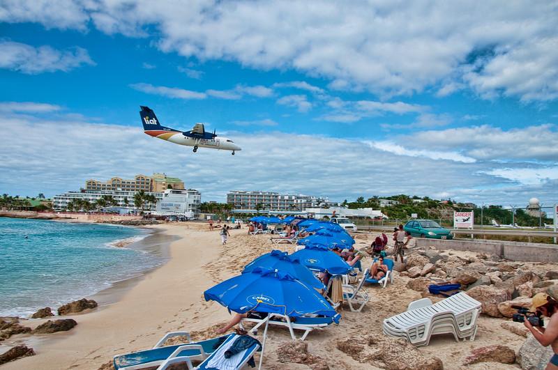 A smaller plane landing over Maho beach.