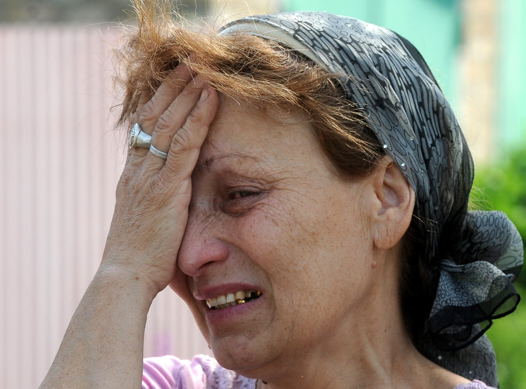 . Mizan Mazasheva, 50, cries at her house destroyed during a night combat between Ukrainian troops and armed pro-Russian militants in the village of Semenovka, near the eastern Ukrainian city of Slavyansk, on May 23, 2014.  AFP PHOTO/ VIKTOR DRACHEV/AFP/Getty Images