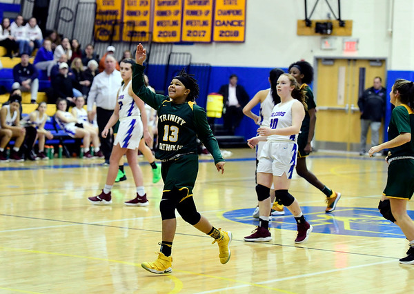 3/8/2019 Mike Orazzi   Staff Trinity Catholic's Caitlyn Scott (13) during the Class S Semifinal girls basketball game at Newtown High School Friday night in Newtown.
