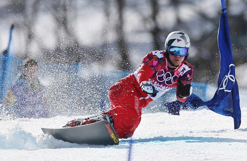 . Nevin Galmarini of Switzerland competes in the final of the men\'s Snowboard Parallel Giant Slalom at Rosa Khutor Extreme Park at the Sochi 2014 Olympic Games, Krasnaya Polyana, Russia, 19 February 2014.  EPA/SERGEY ILNITSKY