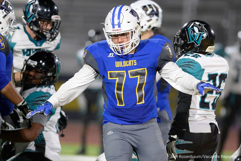 . Will C. Wood defensive lineman, Agustin Miranda  celebrates his third quarter sack of Deer Valley High School quarterback, Joshua Scott.