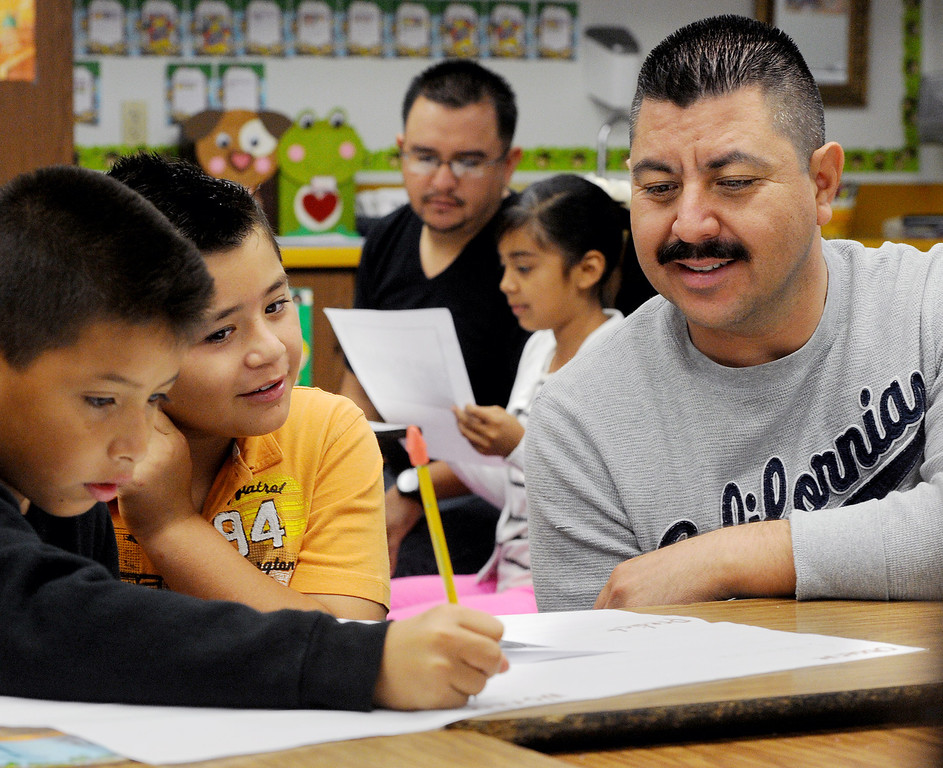 ". John Talavera, Benjamin Huzar, with his father Mario Huizar, right,working on school lesson at Elwin Elementary School in Baldwin Park. Elwin Elementary hosted, ""Bring Your Dad to School\"" Day Wednesday, October 2, 2013.(Walt Mancini/San Gabriel Valley Tribune)"