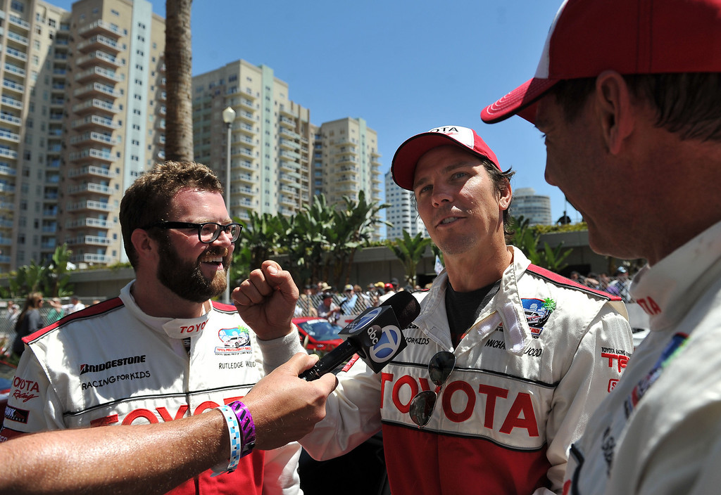 . 4/19/13 - L-R Rutledge Wood, Michael Trucco, and Jeremy Steines chat  after the Friday morning practice of the Toyota Pro/Celebrity race at the 39th Annual Toyota Grand Prix of Long Beach. Photo by Brittany Murray / Staff Photographer