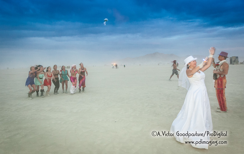 The bouquet toss occurs just as a dust storm starts up.