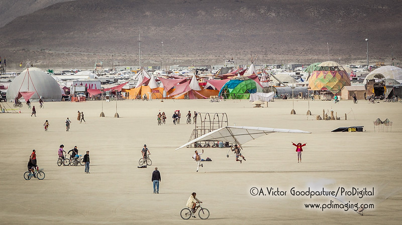 A hang glider attempts to take off by human and a rigging system (seen in lower right). After multiple attempts, he was only airborne a few dozen feet. Winds were unusually calm.