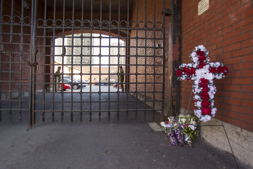 . Flowers at the gate of the John Weir Foote V.C. Armouries in Hamilton, Ontario, October 22, 2014 where it is believed that the soldier who was killed in the attack at the War Memorial in Ottawa this morning was based. A barrage of shots rang out in the Canadian parliament Wednesday as police squads swarmed in to hunt a gunman who shot a soldier guarding a nearby war memorial then ran inside. AFP PHOTO / GEOFF ROBINS/AFP/Getty Images