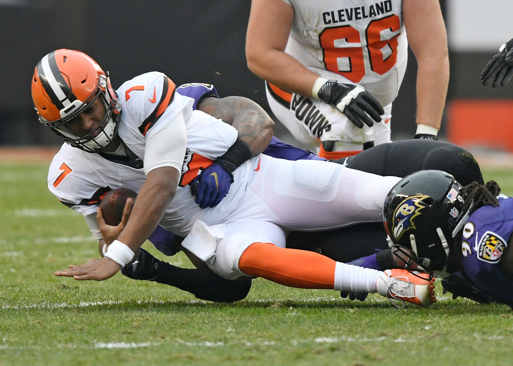 . Cleveland Browns quarterback DeShone Kizer (7) is sacked during the first half of an NFL football game against the Baltimore Ravens, Sunday, Dec. 17, 2017, in Cleveland. (AP Photo/David Richard)
