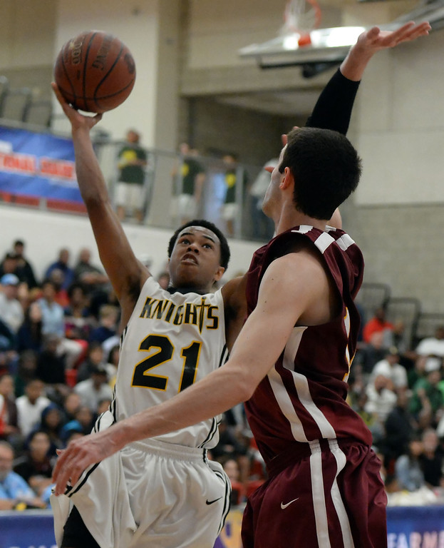 . Bishop Montgomery \'s Justin Bibbins (21) drives to the basket against Cantwell in the second half of a CIF Southern California Regional Division IV basketball game at Colony High School in Ontario, Calif., on Saturday, March 22, 2014. Bishop Montgomery won 66-56.  (Keith Birmingham Pasadena Star-News)