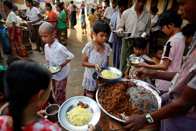 . Food is distributed in a camp for Muslims displaced by recent violence outside Meikhtila April 24, 2013. In Myanmar\'s central heartlands, justice and security is elusive for thousands of Muslims who lost their homes in a deadly rampage by Buddhist mobs in March. Many are detained in prison-like camps, unable to return to neighborhoods and businesses razed in four days of violence in Meikhtila that killed at least 43 people, most of them Muslims, displaced nearly 13,000, and touched off a wave of anti-Muslim unrest fueled by radical Buddhist monks. Picture taken April 24, 2013. REUTERS/Damir Sagolj