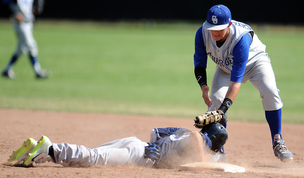 . Duarte\'s Pablo Lopez (C) (3) safe ahead of the tag of Charter Oak first baseman Kevin Ecternkamp in the sixth inning of the Championship game of the Gladstone Baseball Tournament at Gladstone High School on Wednesday, April 3, 2013 in Covina, Calif. Charter Oak won 5-3. (Keith Birmingham Pasadena Star-News)