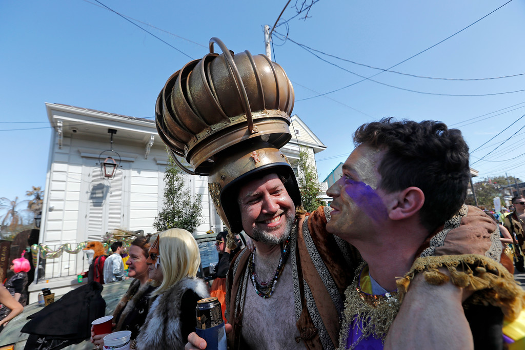 . A man uses an attic vent as headgear during the Society de Sainte Anne parade, on Mardi Gras day in New Orleans, Tuesday, Feb. 13, 2018. (AP Photo/Gerald Herbert)