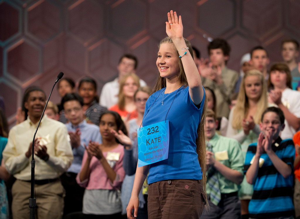 ". Home-schooled eighth grade student Kate Miller, 14, of Abilene, Texas, waves as she bows out of the finals of the Scripps National Spelling Bee competition, Thursday, May 29, 2014, at National Harbor in Oxon Hill, Md. Miller, incorrectly spelled the word ""exochorion\"".  (AP Photo/Manuel Balce Ceneta)"