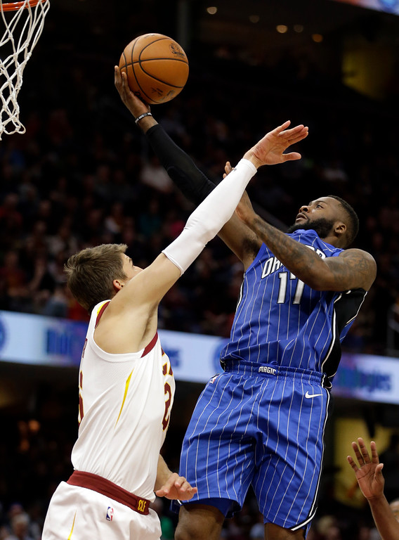 . Orlando Magic\'s Jonathon Simmons, right, shoots over Cleveland Cavaliers\' Kyle Korver in the second half of an NBA basketball game, Saturday, Oct. 21, 2017, in Cleveland. (AP Photo/Tony Dejak)