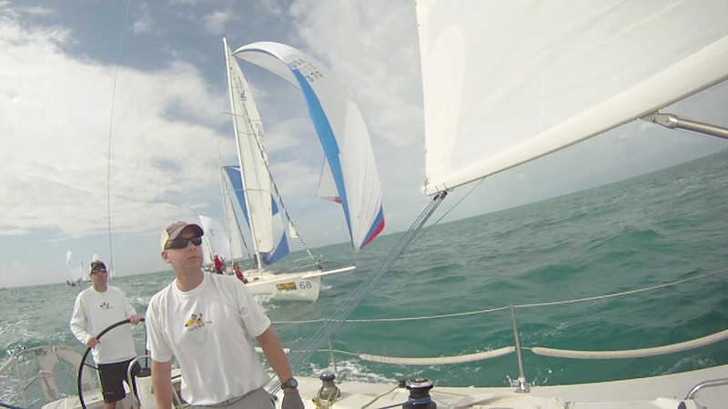 Rob and Travis at the back of the boat with a J105 close on our tail.