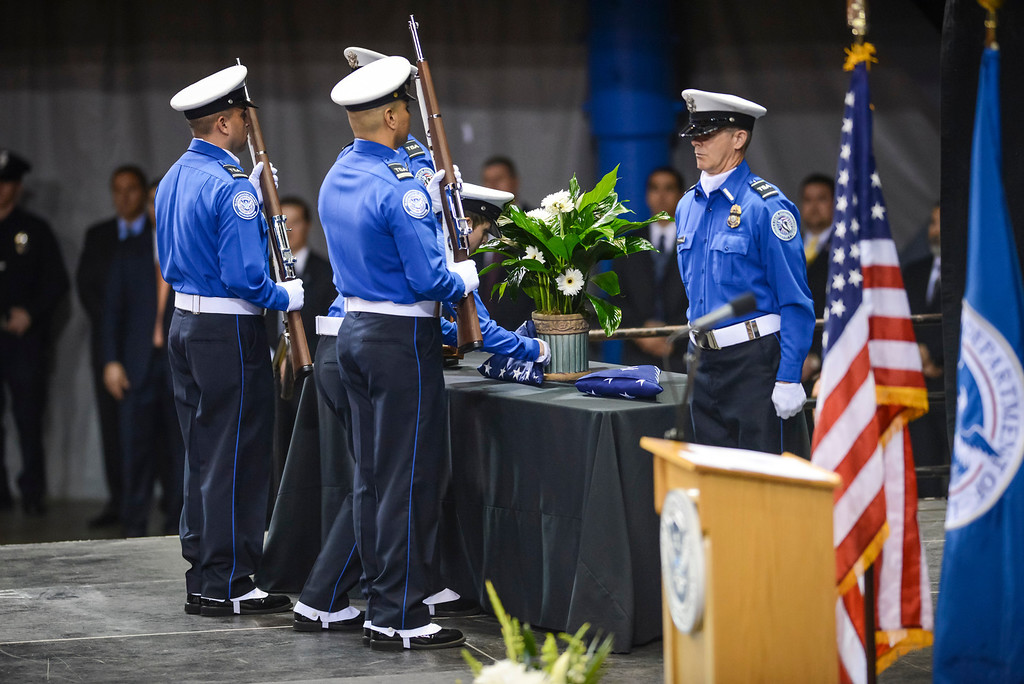 . The flag for slain TSA officer Gerardo Hernandez is presented by TSA officers at the memorial at the Los Angeles Sports Arena Tuesday, November 12, 2013.  A public memorial was held for Officer Hernandez who was killed at LAX when a gunman entered terminal 3 and opened fire with a semi-automatic rifle, Grigsby was wounded in the attack.  ( Photo by David Crane/Los Angeles Daily News )
