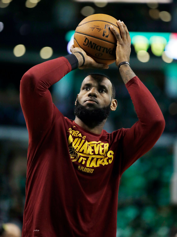 . Cleveland Cavaliers forward LeBron James warms up before Game 5 of the team\'s NBA basketball Eastern Conference finals against the Boston Celtics, Wednesday, May 23, 2018, in Boston. (AP Photo/Charles Krupa)