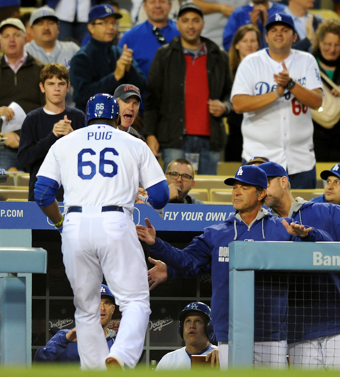 . The Dodgers\' Yasiel Puig is congratulated by manager Don Mattingly after hitting a solo homer in the first inning against the Rockies, Friday, April 25, 2014, at Dodger Stadium. (Photo by Michael Owen Baker/L.A. Daily News)