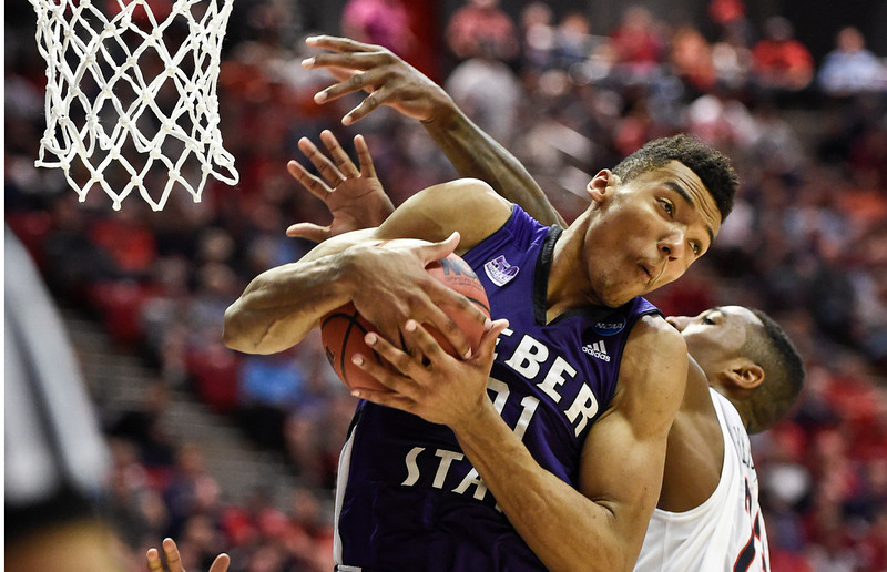 . Weber State\'s Joel Bolomboy pulls a rebound away from Arizona forward Rondae Hollis-Jefferson during the second half in a second-round game in the NCAA college basketball tournament Friday, March 21, 2014, in San Diego. (AP Photo/Denis Poroy)