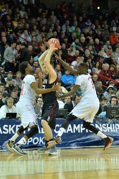 March 20, 2014: Harvard Crimson forward Evan Cummins (33) is trapped by a pair of Cincinnati Bearcats defenders during a second round game of the NCAA Division I Men's Basketball Championship between the 5-seed Cincinnati Bearcats and the 12-seed Harvard Crimson at Spokane Arena in Spokane, Wash. Harvard defeated Cincinnati 61-57.