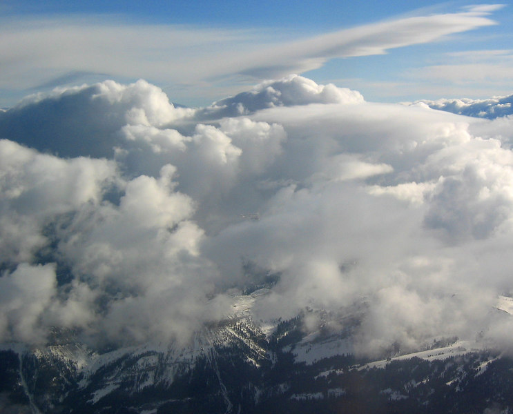 Clouds and mountains from airplane   (Dec 10, 2006, 03:39pm)  On approach to Jackson Hole.