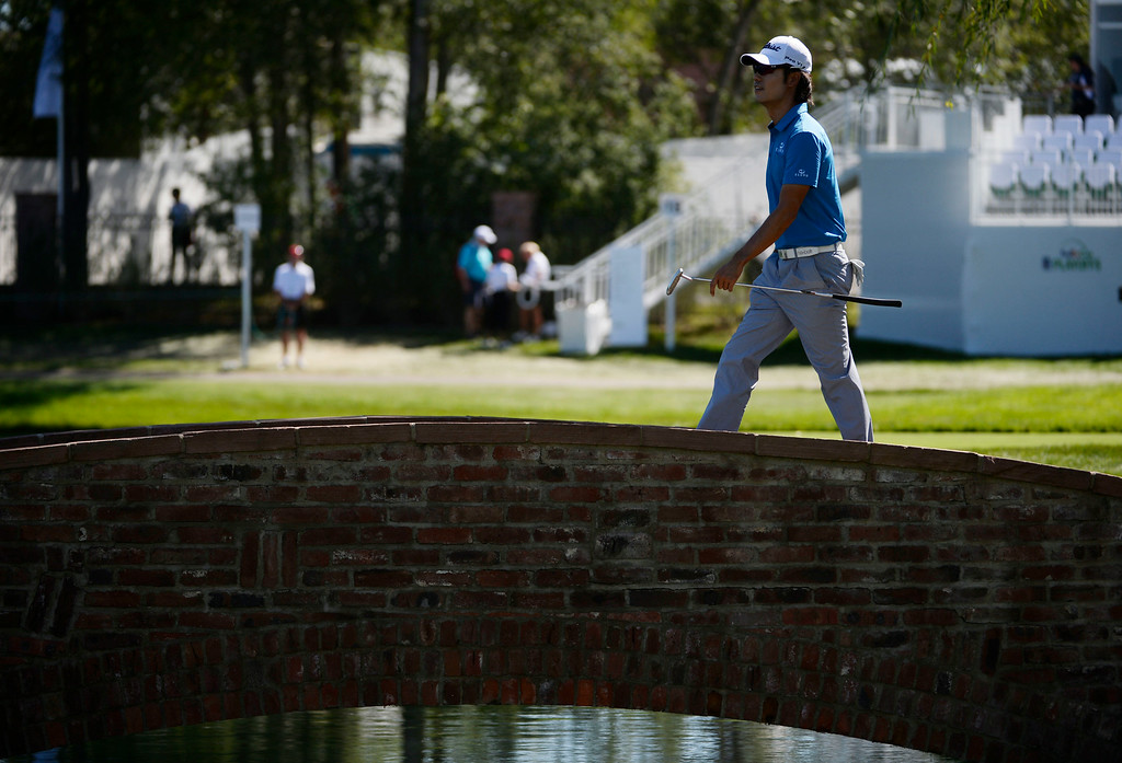 . CHERRY HILLS VILLAGE, CO. - SEPTEMBER 03:  Pro golfer, Kevin Na, walks across the bridge to the 17th green, which is surrounded by a moat at during the FedExCup BMW Championship Pro-Am at the Cherry Hills Country Club Wednesday, September 03, 2014. (Photo By Andy Cross / The Denver Post)