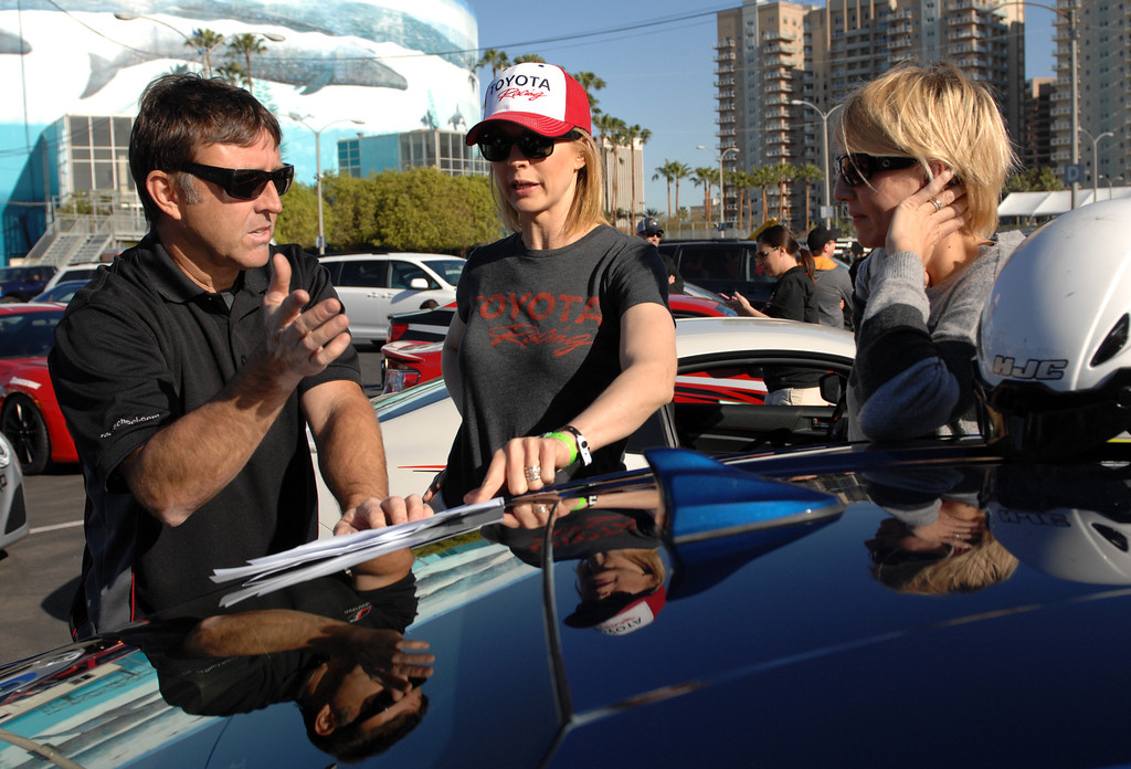 . 4/9/13 -L-R Instructor Scott Atchison, actress Jenna Elfman and Julianne Williams go over driving strategy during media day for the 39th Annual Toyota Grand Prix of Long Beach. The celebrity/pro races spent the day practicing on the track, joking with their racing partners and giving interviews. Photo by Brittany Murray / Staff Photographer