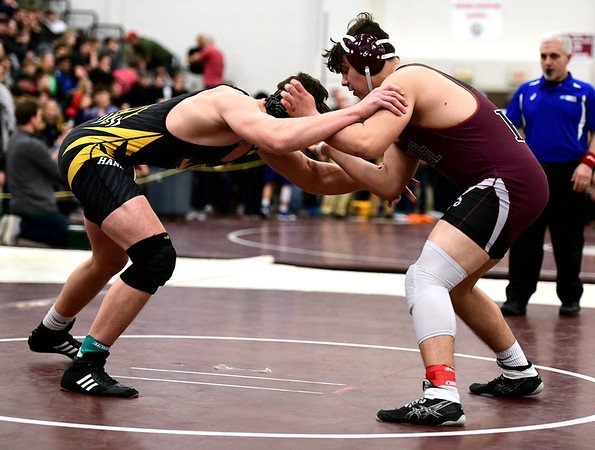 2/16/2019 Mike Orazzi | Staff Bristol Central's Jakob Salinas and Daniel Hand's Alec Dube during the CIAC state open wrestling tournament at Bristol Central High School in Bristol Saturday.