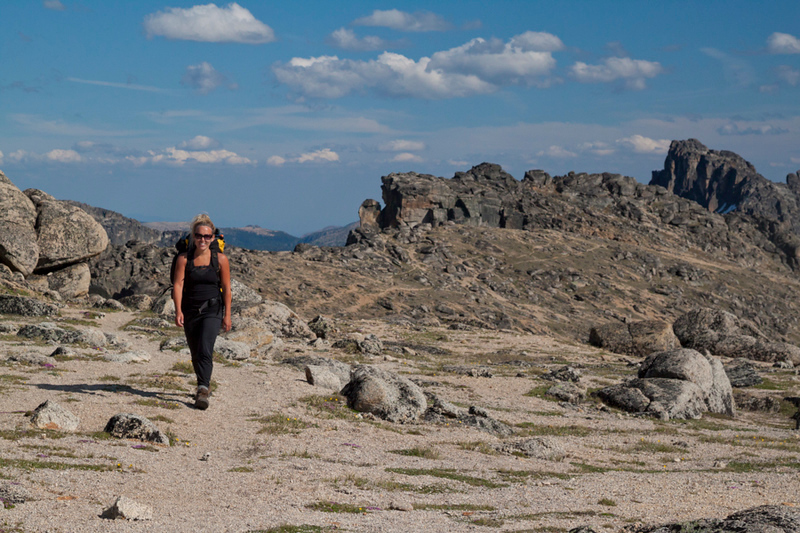 A fit woman hiking in Cathedral Lakes Provincial Park.