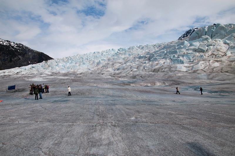 People await the helicopters.   On top of this mountain of snow is the lake on the glacier.
