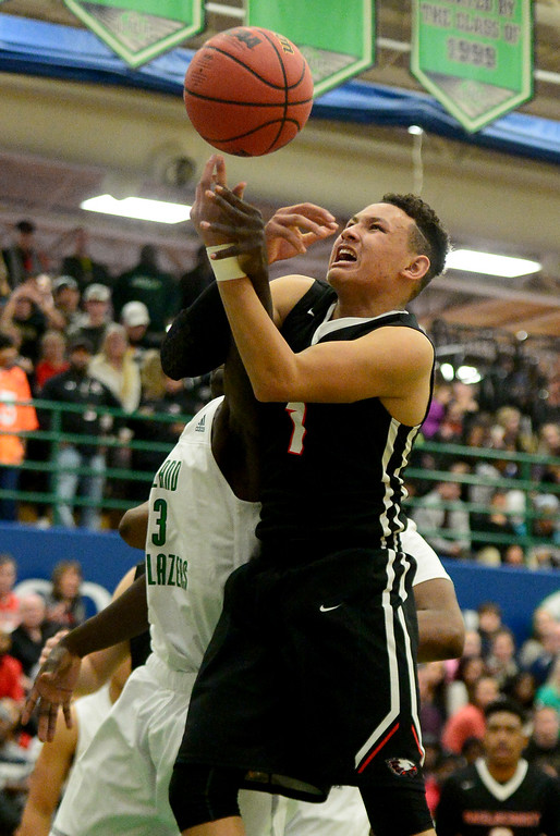 . Colbey Ross (1) of EagleCrest  grabs a rebound away from Alijah Halliburton (23) of Overland during the second half of EagleCrest\'s 57-45 win. The Overland Trailblazers hosted the Eaglecrest Raptors on Friday, January 8, 2016. (Photo by AAron Ontiveroz/The Denver Post)