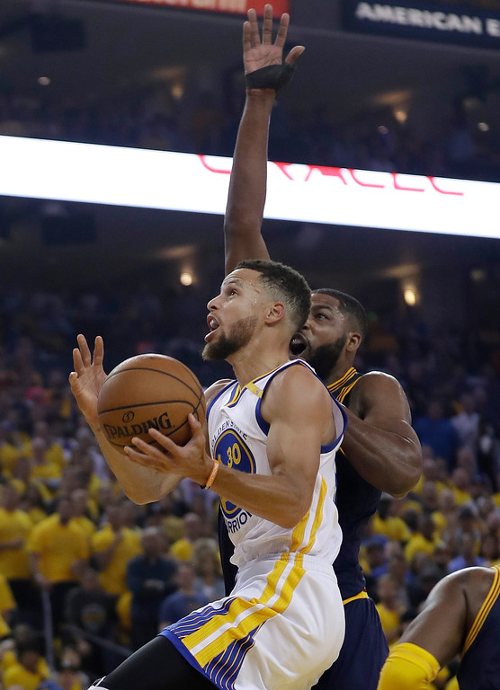 . Golden State Warriors guard Stephen Curry (30) shoots against Cleveland Cavaliers center Tristan Thompson during the first half of Game 1 of basketball\'s NBA Finals in Oakland, Calif., Thursday, June 1, 2017. (AP Photo/Marcio Jose Sanchez)